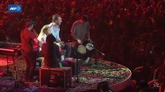 Shakira y Chris Martin cantan en concierto benéfico del G20