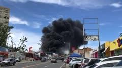 Un negocio se incendia en la avenida Winston Churchill de Cupey