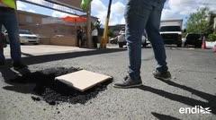 Mira cómo puedes tapar un hoyo de la calle por tu cuenta
